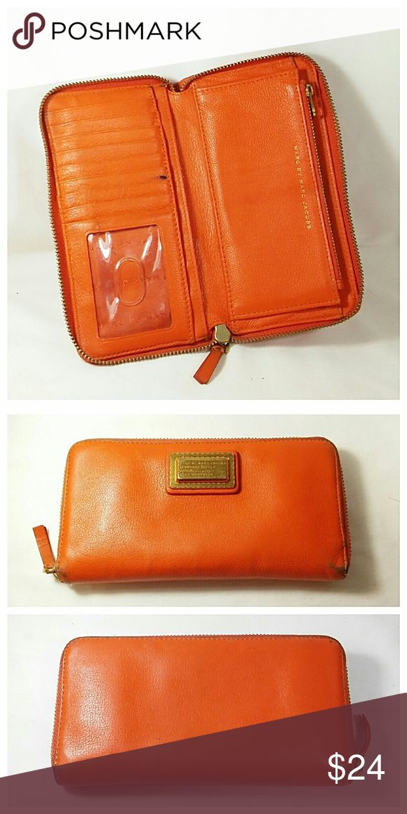 "Marc Jacobs Zip Around Leather Wallet Pretty orange wallet with a smooth running three sided zipper. It has lots of pockets to keep you organized. As you can see it does show some wear, especially on the corners, but is in good shape overall. Measures 8"" x 4"". 💥 Reasonable offers accepted 💥 Marc By Marc Jacobs Bags Wallets"