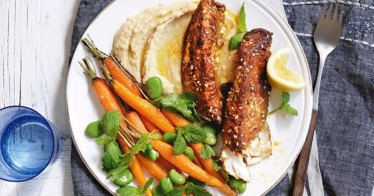 Create a new family favourite with this spice-crusted fish served with hummus, roast carrot salad and fresh lemon wedges.