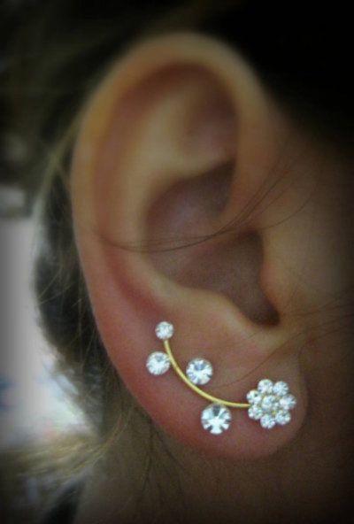 earrings: multiple stacked earrings and ear cuffs