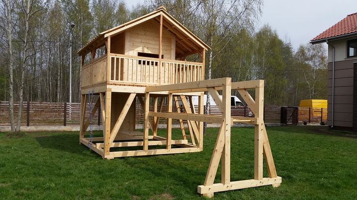 A wooden cabin for kids with Gibbon ladder