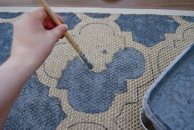 Painted Rugs: an uncoated rug with latex based paint and protect with a waterproof spray