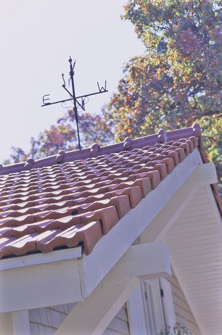 red tile roof and weather vane