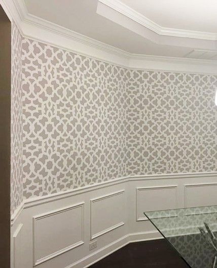 A DIY gray and white stenciled dining room wall using the Zamira Allover Stencil from Cutting Edge Stencils. http://www.cuttingedgestencils.com/moroccan-stencil-designs.html