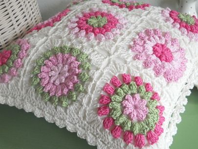 granny square pillow.  love the method of joining and the edging.