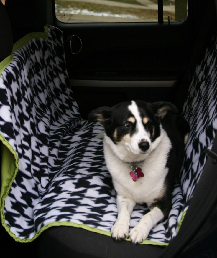 DIY Dog Car Seat Cover Tutorial -- hammock style keeps them from jumping into the front and keeps them from hurting themselves if there is a sudden stop...and keeps the hair out of the car! (Tip: I would probably make this out of a waterproof fabric instead of fleece just in case of accidents & to be wiped down easier)