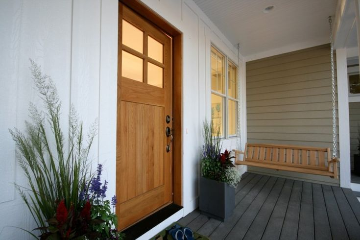 craftsman style front door dark floor hanging bench white wall decorative plants beach style entry of Elegantly Beautiful Craftsman Style Front Doors to be Amazed By
