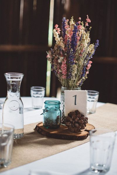 Pink, purple and white dried flower bouquets, pine cones and wooden slices {Imagen Photography & Videography}