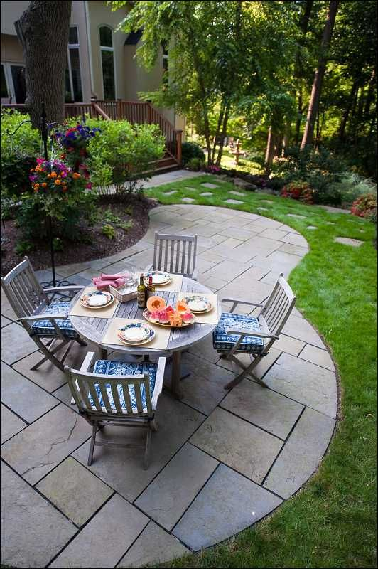 Bluestone dining patio and deck with re-configured stairs  Click directly on the photo to enlarge it in a pop-up.