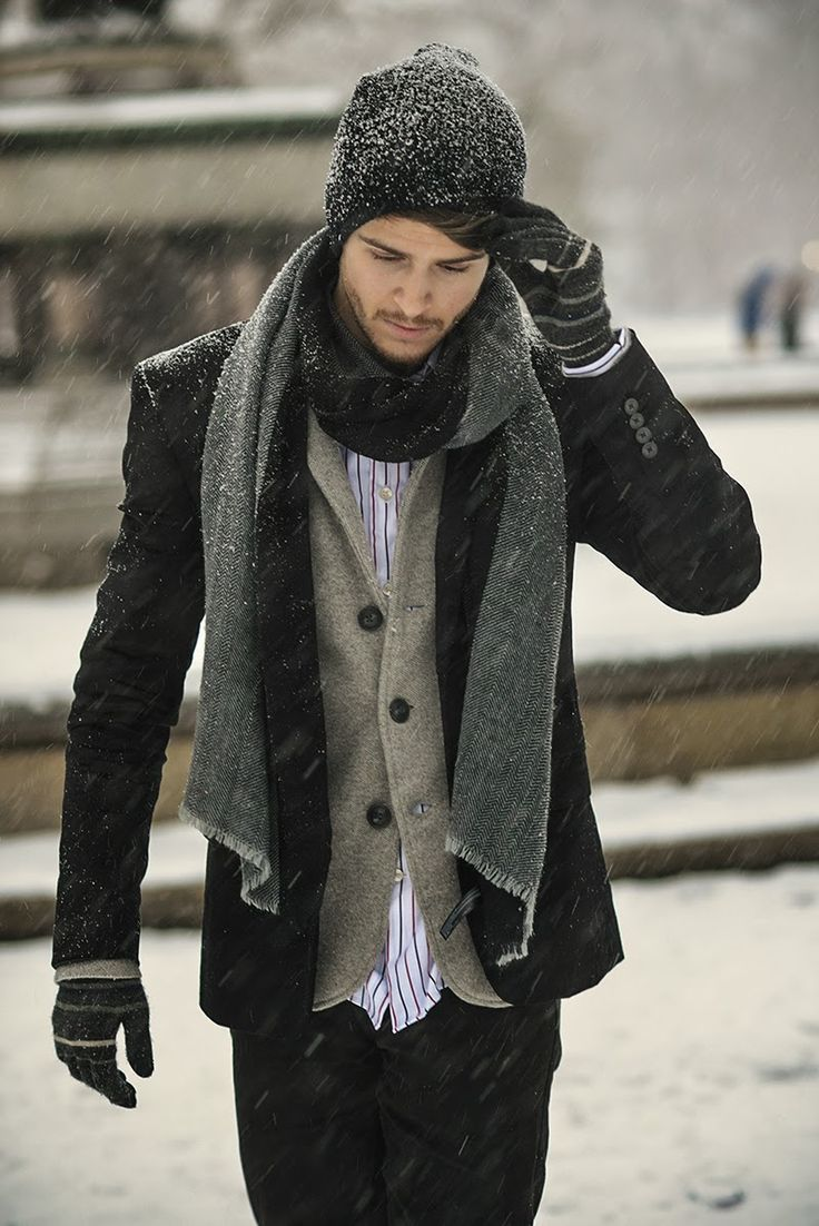 Pair a black pea coat with black jeans for a dapper casual get-up.  Shop this look for $272:  http://lookastic.com/men/looks/beanie-scarf-longsleeve-shirt-blazer-pea-coat-jeans-gloves/4141  — Black Beanie  — Charcoal Scarf  — White and Red Vertical Striped Longsleeve Shirt  — Brown Wool Blazer  — Black Pea Coat  — Black Jeans  — Black Horizontal Striped Wool Gloves