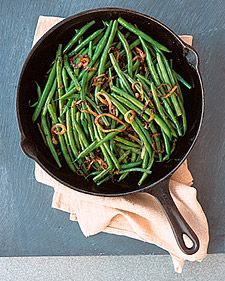 1 teaspoon coarse salt, plus more for seasoning 1 pound string beans, stem ends trimmed 2 teaspoons vegetable oil 1 teaspoon brown mustard seeds 1 small yellow onion (about 4 ounces), peeled and thinly sliced into rounds 2 teaspoons minced ginger (1/2-inch piece)