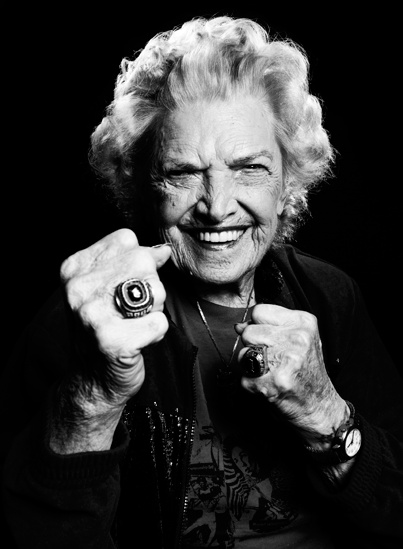 """Within the sisterhood of female wrestlers, Mae Young became legendary for her toughness and bravado. """"She had men's shoes on, men's pants on with a zipper down the front, a cigar hanging out of her mouth,"""" recalled Penny Banner, a nineteen-year-old prospect from St. Louis who joined Wolfe's troupe years later. """"And she looked at me and said 'Hi, fuckface.'"""""""