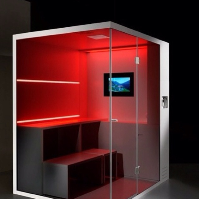Sauna/ shower with tv and cool color effects. Yes please!!