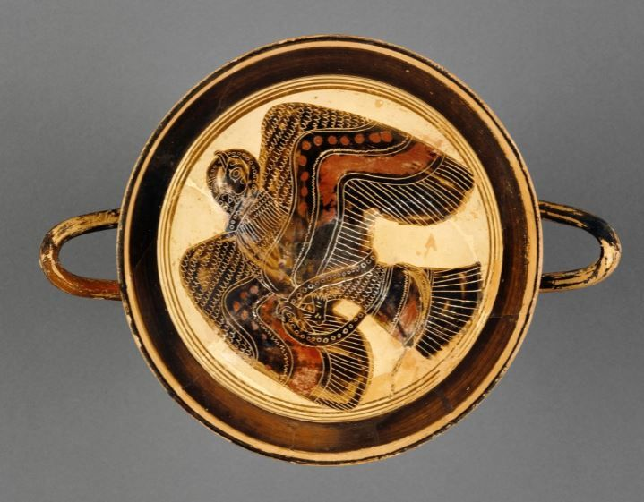 Lakonian black-figure kylix attributed to the Hunt Painter, 565 - 530 B.C. A bird sign appeared to them, flying high and holding to the left and carrying in its talons a gigantic snake, blood-colored, alive still, and breathing, it had not forgotten its warcraft yet, for writhing back it struck the eagle that held it by the chest and neck, so that the eagle let it drop groundward in pain of the bite, 19.5 cm diameter. Getty museum