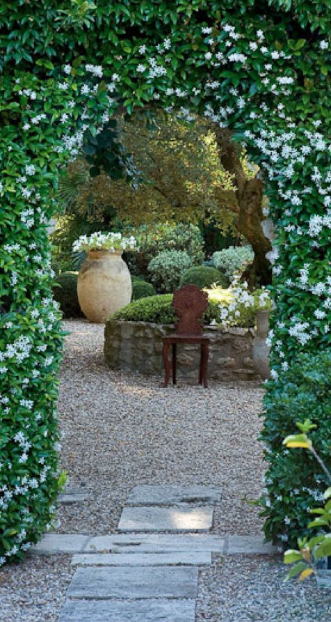 Star jasmine arch and patio in Provence, France • Clive Nichols Garden Photography