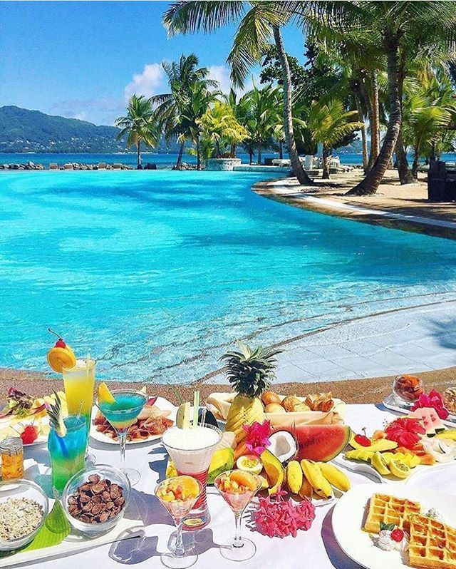 """""""Good morning from Seychelles with a blue sky, great food and  great energy ☀️🍉🍹 📸 @take_me_to_africa . . . . . . . . . . #goodmorning #riseandshine #saturday #mood #vibes #travel #luxury #luxurytravel #live #life #relaxing #seychelles #africa #africanluxury #chill #luxurylifestyle"""" by @theluxedigest."""