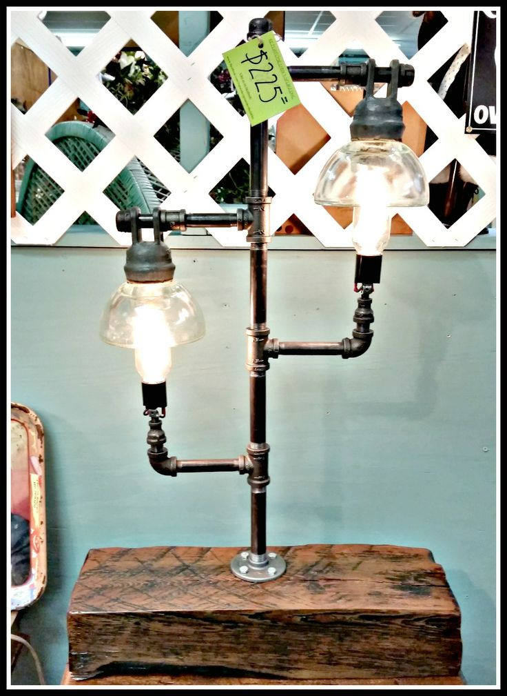 Repurposed high voltage insulator lamp with pipe fittings. Follow us for more wonderful pins at www.pinterest.com/3spurzdandc www.facebook.com/3SpurzDesignsAndCollectables www.3spurzdesignsandcollectables.com