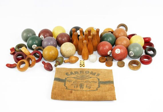 Get your retro game on with this awesome instant vintage toy collection! Display it in a glass bowl, in a display case, or on a shelf.  These vintage pieces show wear, discoloration, and some hairline fractures on the pool balls from age and use. This fantastic lot comes inside a vintage linen bag, which reads Carroms, Ludington, Mich. SInce 1889. Instant toy collection includes: 15 Clay pool balls (1 1/2 diameter) 2 New York City Board of Education Ping Pong Balls (1 1/2 diameter) ...