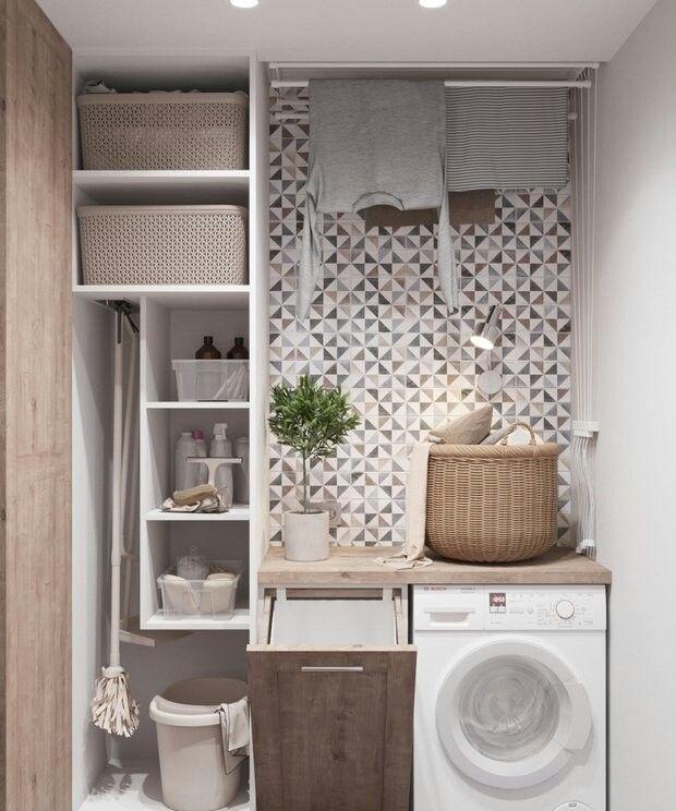 Use slim bookshelf for storage in laundry room