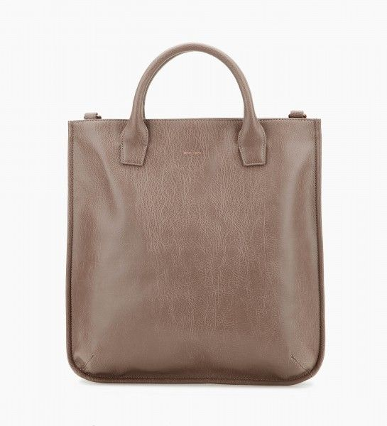 """Dwell Deeter Matt and Nat Vegan Leather  Tote that can be worn as a handbag or crossbody, with adjustable and removable strap. Zippered top closure. Shoulder strap drop: 19.5"""". Handle drop: 4.5"""". Interior: zipper pocket, slip pocket, logo-embossed cork tag. 100% recycled plastic bottles nylon lining.   Dimensions: 16.5"""" X 17"""" X 3.5"""""""