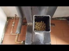 Mk 1 rocket stove, Gravity fed pellet burner Heats a 300 ltr water tank - YouTube