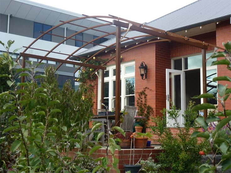 curved metal pergola roof