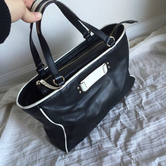 """Kate Sapde leather black and Ivory tote bag ❤️ Color black and Ivory , genuine leather , the bag is great condition inside and outside, light wear on the ivory parts, size 12.5x9 , strap drop 6"""" , no ripped no stain kate spade Bags Totes"""