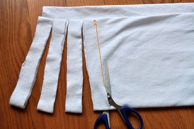 How to cut t-shirts in a continuous strip for DIY t-shirt yarn.