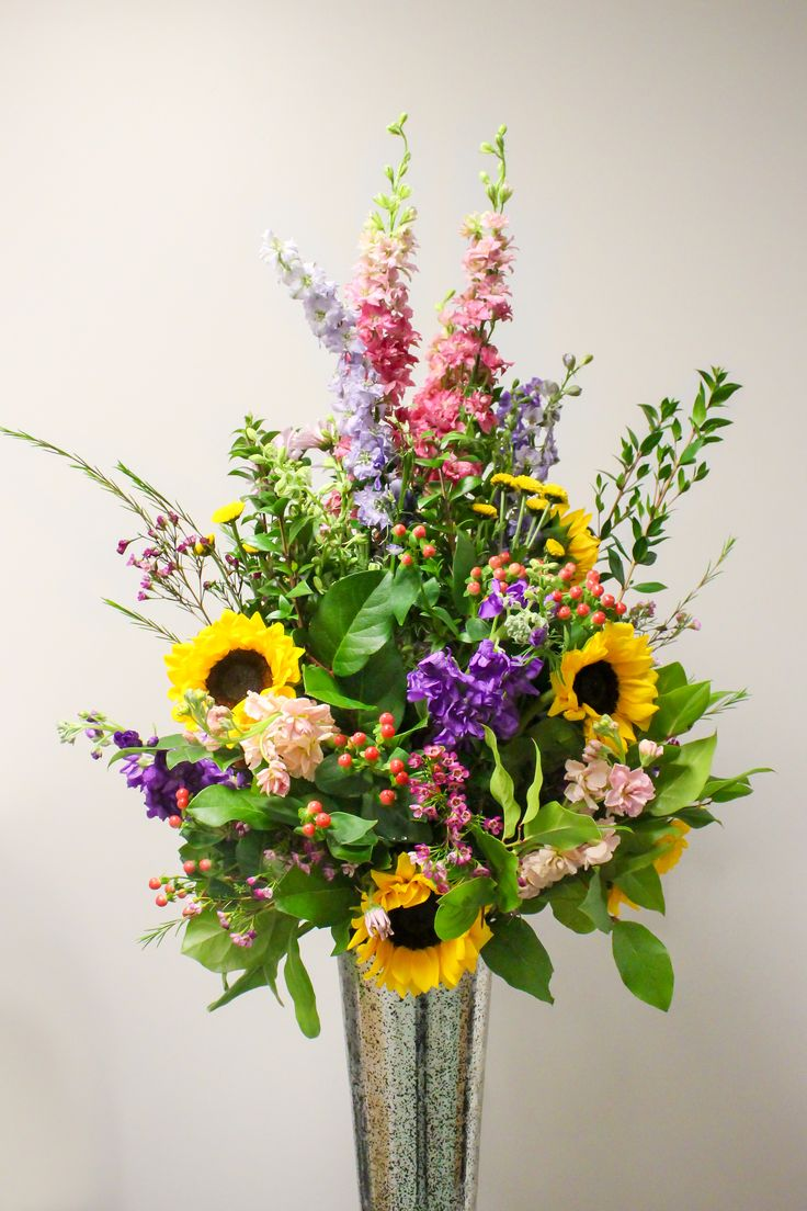 Tall centerpiece with Australian wax flower, sunflowers, pink & purple larkspur, peach & purple stock, myrtle & lemon leaf, coral hypericum, & yellow button mums. #wedding #event #inbloomfloral #powerstationevents #ctwedding