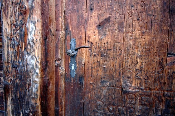 Wooden door of larch in Nendaz, Wallis, Switserland