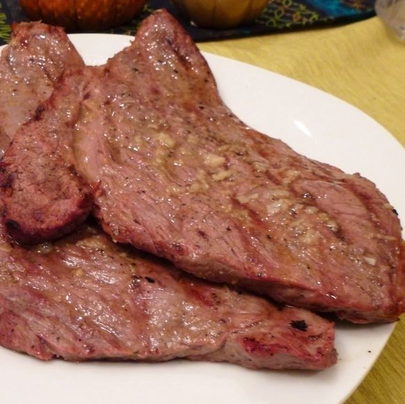 These steaks are a treat and a great way to make an inexpensive cut of meat memorable.  You can use bottom round (best), top round, or a thin cut sirloin for this dish.  The steaks should be cut about a 1/2 thick. Mine were a little thicker, so I pounded them with a mallet to thin them.