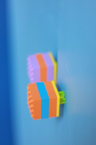 Fun and colourful door pulls made from Lego for Edward's custom designed Mezzanine