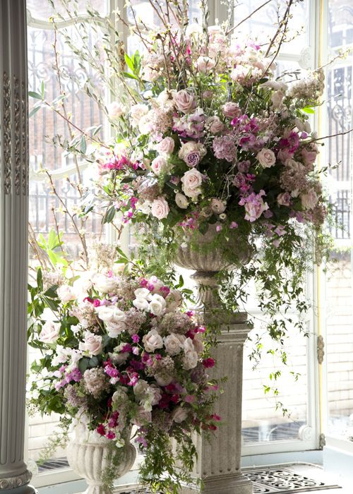 Stunning pedestal arrangements by Victoria Flowers
