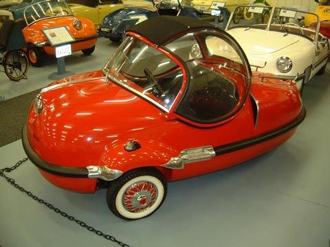 1956 Avolette Tourisme (de Luxe). The Avolette was available in five different versions, all with single-cylinder, 2-stroke motors and 3 or 4 wheels. The Competition Deluxe utilized a differently styled fiberglass shell. There was a connection to the Societe France Jet, in 1958, producing Brutsch's V2N design.  Numerous accessories were available at extra charge, including the forward-tilt hardtop, luggage carrier, hubcaps, and windshield wiper, all to be seen on this car.