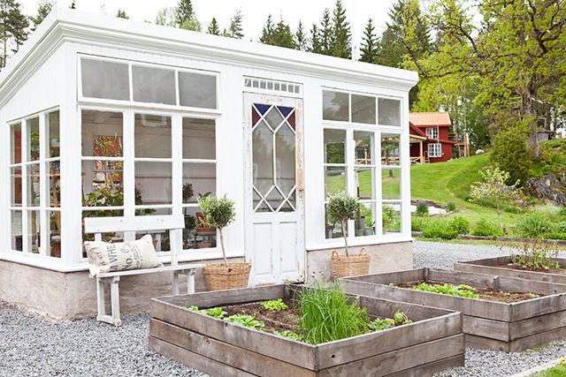 Great idea with raised beds in front of the greenhouse... And the bench makes it look so inviting....