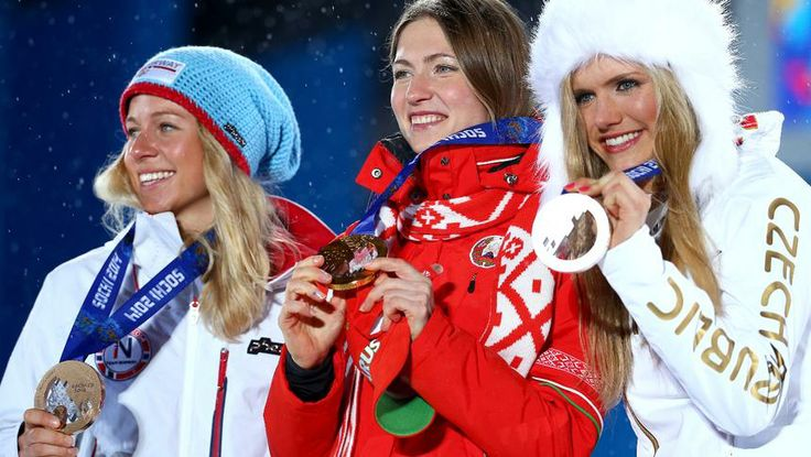 32/32 Women's biathlon 12.5 km mass start Bronze medalist Tiril Eckhoff of Norway, gold medalist Darya Domracheva of Belarus and silver medalist Gabriela Soukalova of the Czech Republic celebrate on the podium during the women's biathlon 12.5 km mass start Medal Ceremony.