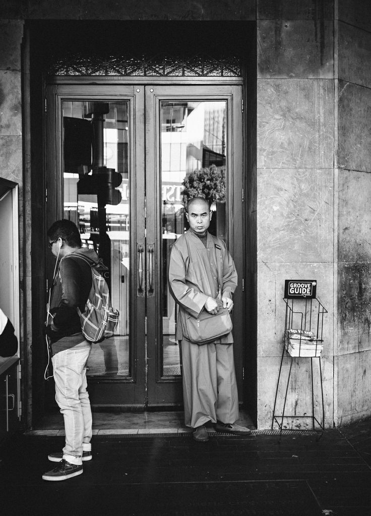 Monk's Stare – The Civic, Auckland  I'm not very familiar with my Far Eastern traditions, but I think if a monk stares at you with this level of intensity, you get 6 years of good luck. Or is that 6 years of bad luck...  Photo notes: Taken with an Olympus OMD EM5 and a Panasonic 25mm f1.4 lens. Street photography. Black and white.