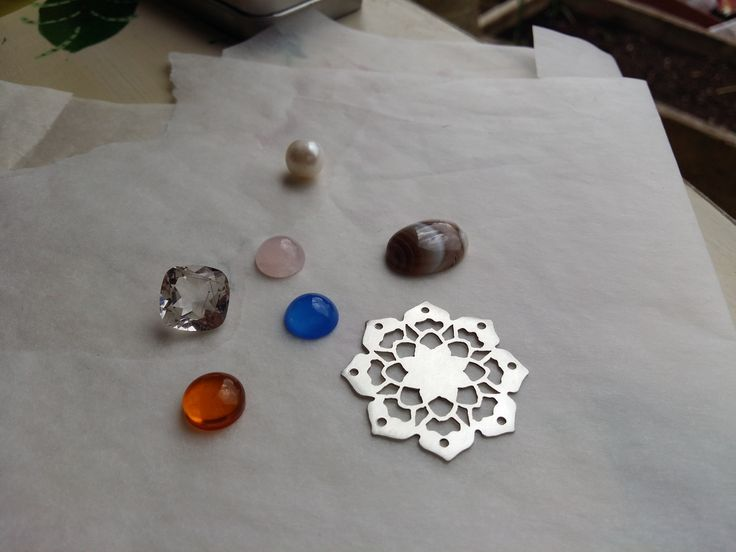 Choosing a stone for this mandala pendant. Soon to be for sale at https://www.etsy.com/uk/shop/themondaysilverworks