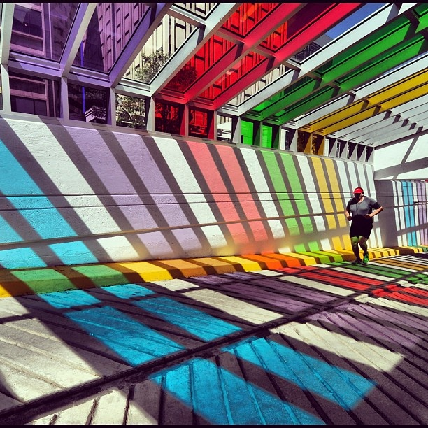 "@edmontonjournal's photo: ""John Bowers jogs through the #rainbow #colors today on the ramp of the Library Parkade. (Photo by staff photographer John Lucas) #yeg #running"" #Colour #Edmonton #Alberta #Beautiful #Photography"