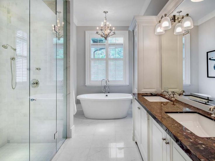 Images On A clean color palette of white and gray this contemporary bathroom is the ultimate place