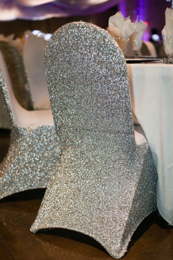 Sparkling wedding decor sparkling wedding chair covers.  Photographed by Lyla Hamdon Photography  http://calgarybride.ca/decor-inspiration/25019/