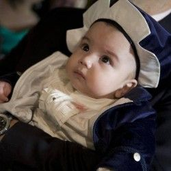 """Baby boy wearing the """"Little Lord"""" christening suit and hat."""