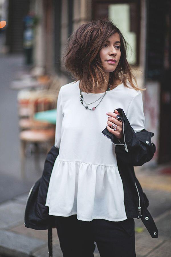White, feminine peplum top under leather jacket