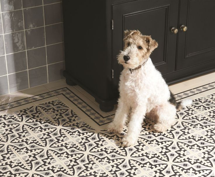 Romanesque tiles from the Odyssey collection by Original Style (cute dog not included). This whimsical pattern is like a sample of exquisite embroidery - or a star motif from a filigree lamp. A design loosely inspired by intricate lace and needlework as well as metalwork and jewellery, Romanesque comes in seven colour ways, from dramatic grey on black to light blue and grey on white. It look stunning everywhere, fro, a courtyard to a hallway.
