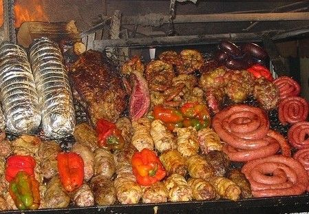 "Uruguay's main dish and probably the most well-known Uruguayan         food in the world is the ""asado"". Unlike other countries of Latin         America where the diet revolves mostly around legumes and cereals (essentially         corn, beans and rice), in Uruguay the great availability of red meats makes         asado a central culinary expression of our culture and identity."