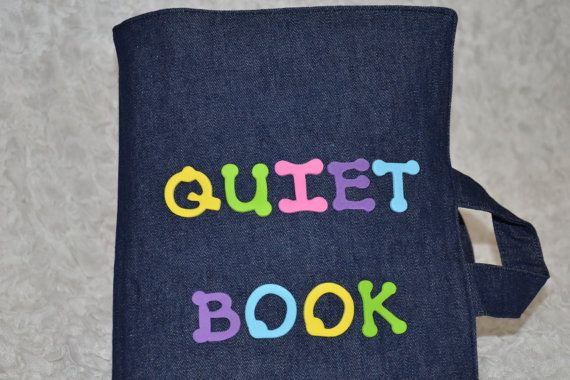 """Quiet Book"" made of fabric. Inside are felt shapes and animals, a felt clock, a lot of tactile learning tools. Would be great for church with a little one. :)"