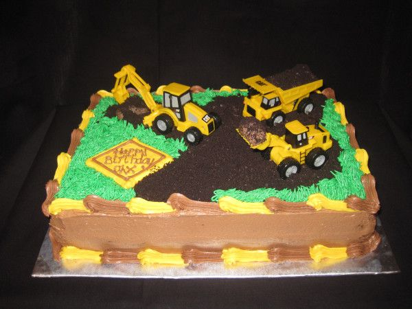 This cake was made for a friend of mine who's little boy is celebrating his first birthday this weekend! The party theme revolved around dump trucks and other construction vehicles, so the ca…