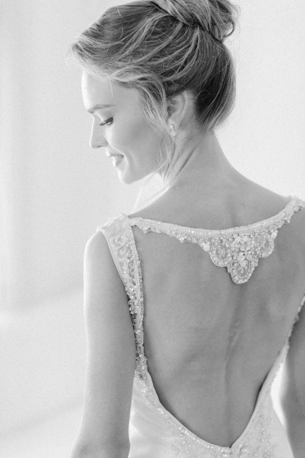 Embellished open back wedding dress: http://www.stylemepretty.com/2016/07/22/mykonos-island-greece-destination-wedding/   Photography: Anna Roussos - Photographer - http://annaroussos.com/