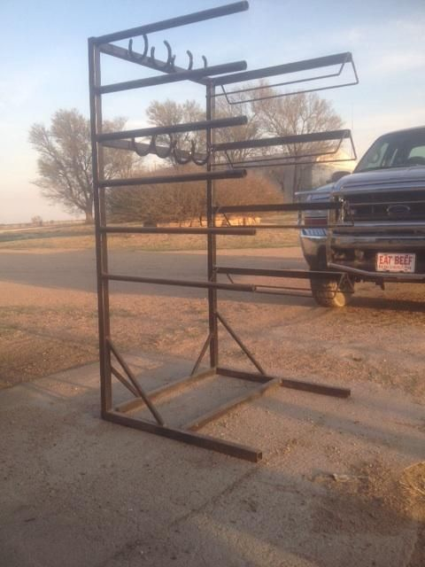 Tack rack with six blanket or pad racks, four saddle racks, and eight horseshoe headstall/halter/rope hooks. Makes it possible to keep all your tack in one convenient spot and avoid clutter. Its built to last. I would like to put it toward a trade on an association saddle or team roping saddle. Thanks for looking.