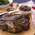 Grilled T-Bone Steaks with Balsamic Onion Confit.  Don't let the word 'confit' throw you-- it's just onions cooked down to where they're soft, caramelized and totally delicious.