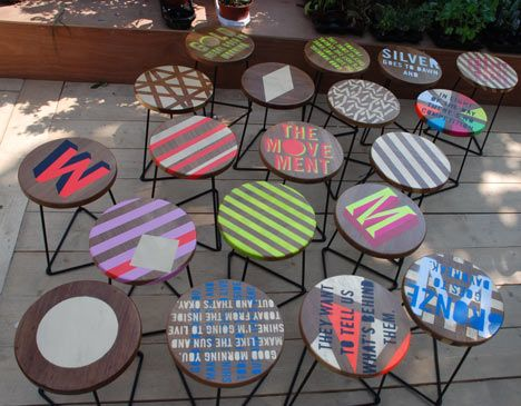 MVMNT Cafe by Morag Myerscough. Artist Luke Morgan painted the stools made from reclaimed wood. Pop- up cafe. London.
